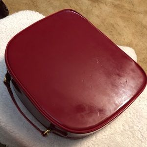 Red Ester Lauder small suitcase or makeup case